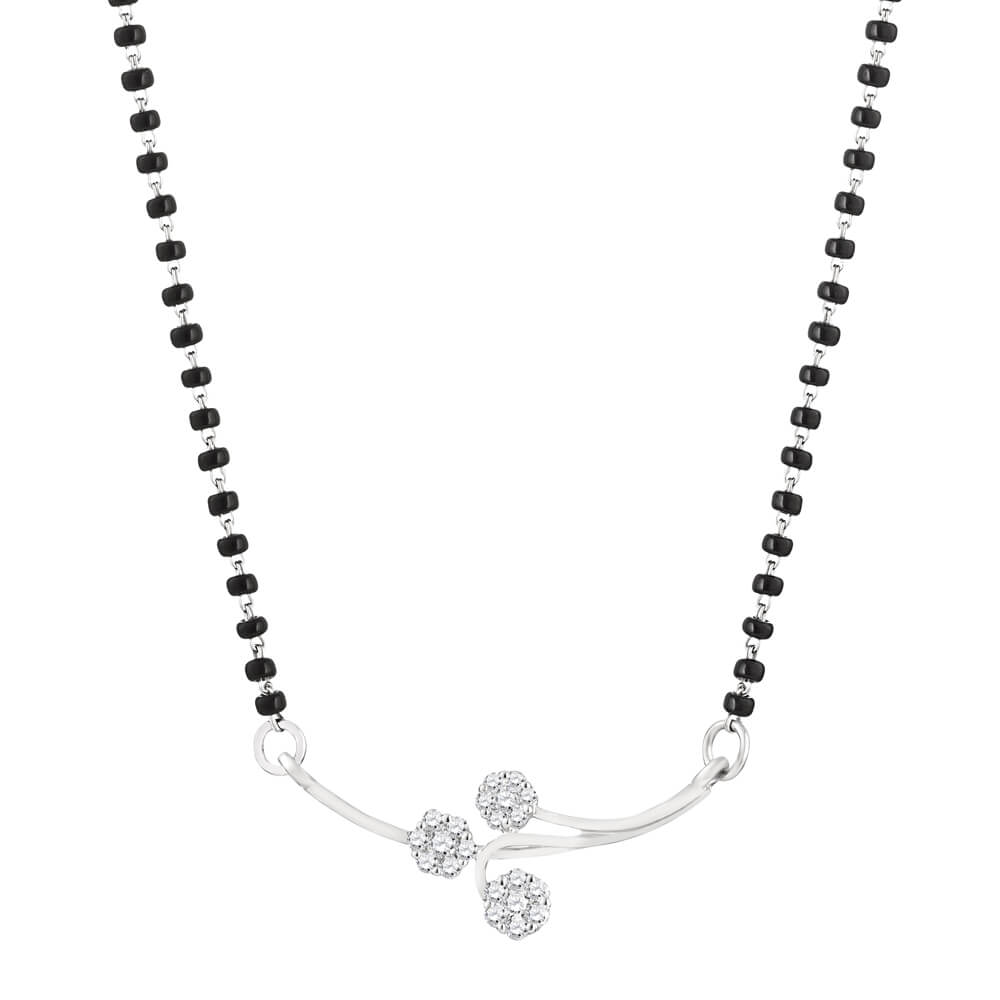 18ct White Gold Single Chain Diamond MangalsutraTotal wt. 5.5 gDiamonds wt. 0.30 caratLength. 18 InchesSku 32016All prices include VATAll our Products are Hallmarked by London Assay OfficeComes With Presentation BoxDelivery IncludedContact us / Live Chat with us for Video of Product