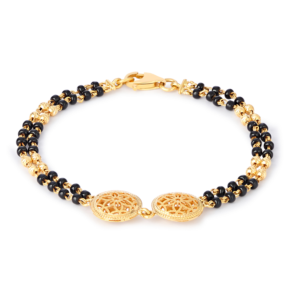 22ct Gold Baby bracelet.With black beads.Suitable for kids, Children, Child, Infant, New Born.22ct Hallmarked Kids gold jewellery.Approximate Length : 5.5 Inches or 14cm.Wt : 6.1gsku 30513All prices include VAT22ct GoldHallmarked by London Assay OfficeComes With Presentation BoxDelivery IncludedLive chat with us for availability and more images of similar black beads bracelet for babies.
