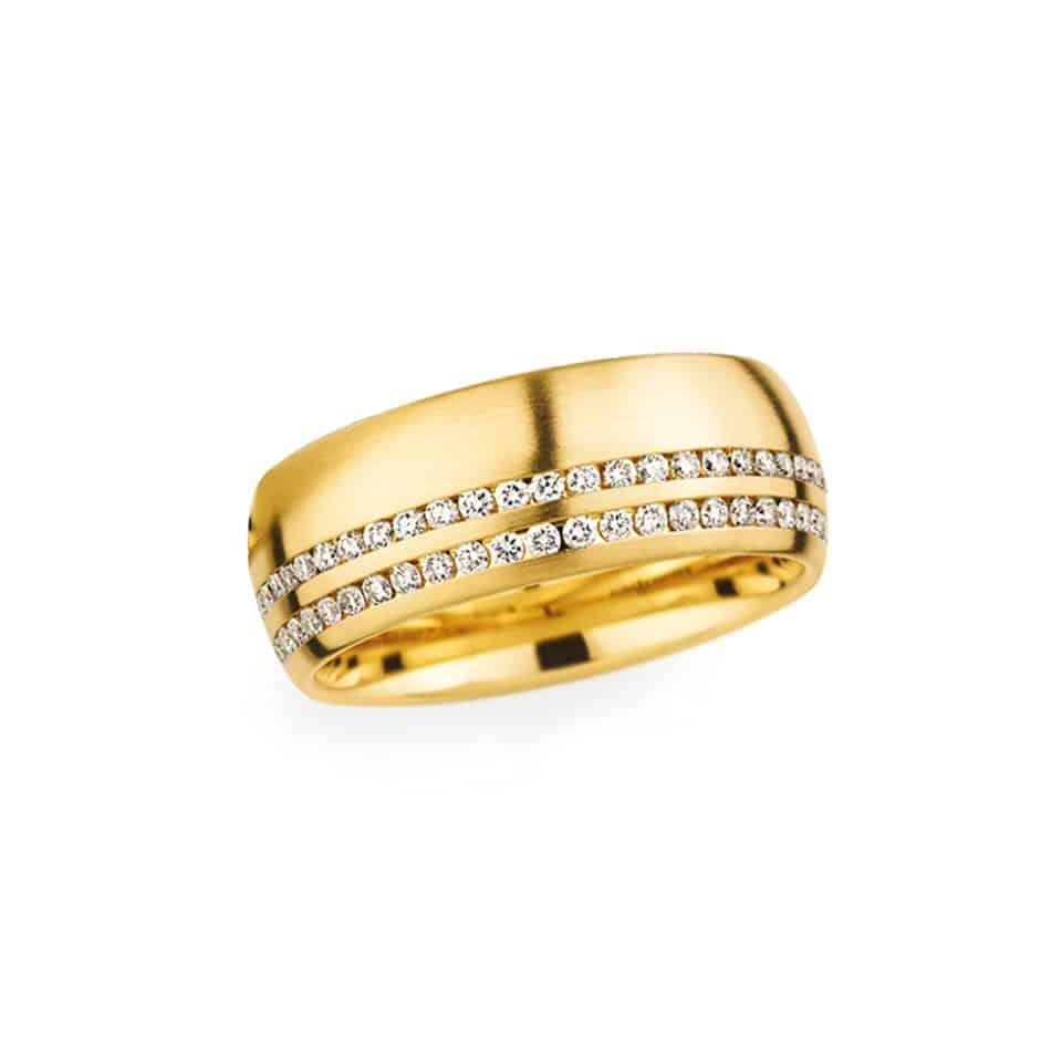 For the truly beloved, this luxurious wedding ring features a divine double row of diamonds. They sparkle against a backdrop of softly brushed gold. Your ring is for life, so choose with your heart – this one's destined for someone extremely special. With 0.43 carat of brilliant cut diamonds, it will catch the light at any angle. It has been handcrafted at the state-of-the-art production facility in Welzheim by Christian Bauer's team of experienced jewellery-makers. PureJewels is proud to be an authorised stockist of Christian Bauer wedding rings in London. *Your ring will be ordered, unless we have your size in stock. To choose your size – or request a different metal – just open Live Chat.*Christian Bauer diamond wedding ringMetal: 18ct Yellow GoldWidth: 7.5 mmStones: 59 Brilliant cut diamondsDiamond weight: 0.43 ctChoosing the finish for your Christian Bauer wedding ringSince your Christian Bauer wedding ring is ordered from the workshop in Germany, you may personalise it to suit your style. Choose to have this double diamond wedding ring finished with rose gold or pure platinum. Open Live Chat to find out what's possible and specify the size for your ring. Or come into the show room and we can show you all the latest Christian Bauer wedding rings.