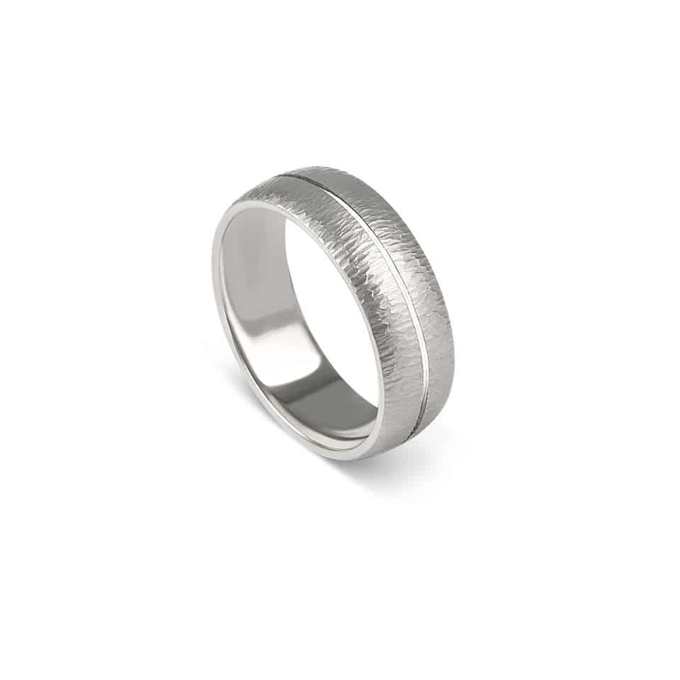 A distinguished men's wedding ring from Christian Bauer. The platinum is textured to create an irresistibly tactile ring, reminiscent of ripples on water. The central groove adds interest. If you're wondering who to trust to make your wedding ring, Christian Bauer has you covered. Christian Bauer is a world-renowned jeweller based in Germany for over 60 years. Today, its skilled craftspeople combine careful handiwork with state-of-the-art machines to create the label's recognisably stylish wedding rings. PureJewels is a long-standing UK stockist of Christian Bauer wedding rings: use Live Chat to order yours to size, or ask us what's in stock.Authorised Christian Bauer London StockistMen's platinum wedding ringRing number 274458Metal: PlatinumWidth: 7.0 mmAvailable on back-order*Open Live Chat to order.Visit an authorised Christian Bauer stockist in London.Browsing wedding rings online can be daunting. It's a significant purchase. And it's probably more reassuring to order from a real bricks-and-mortar jeweller: if you need to return or resize your ring, we're here (on Green Street in E7). Come in and discover the latest Christian Bauer wedding rings in real life. Or, if you're far away, just open Live Chat. You'll reach an actual, in-store advisor who can send you snaps of our stock. We're here to help you choose the right wedding ring at the right price.