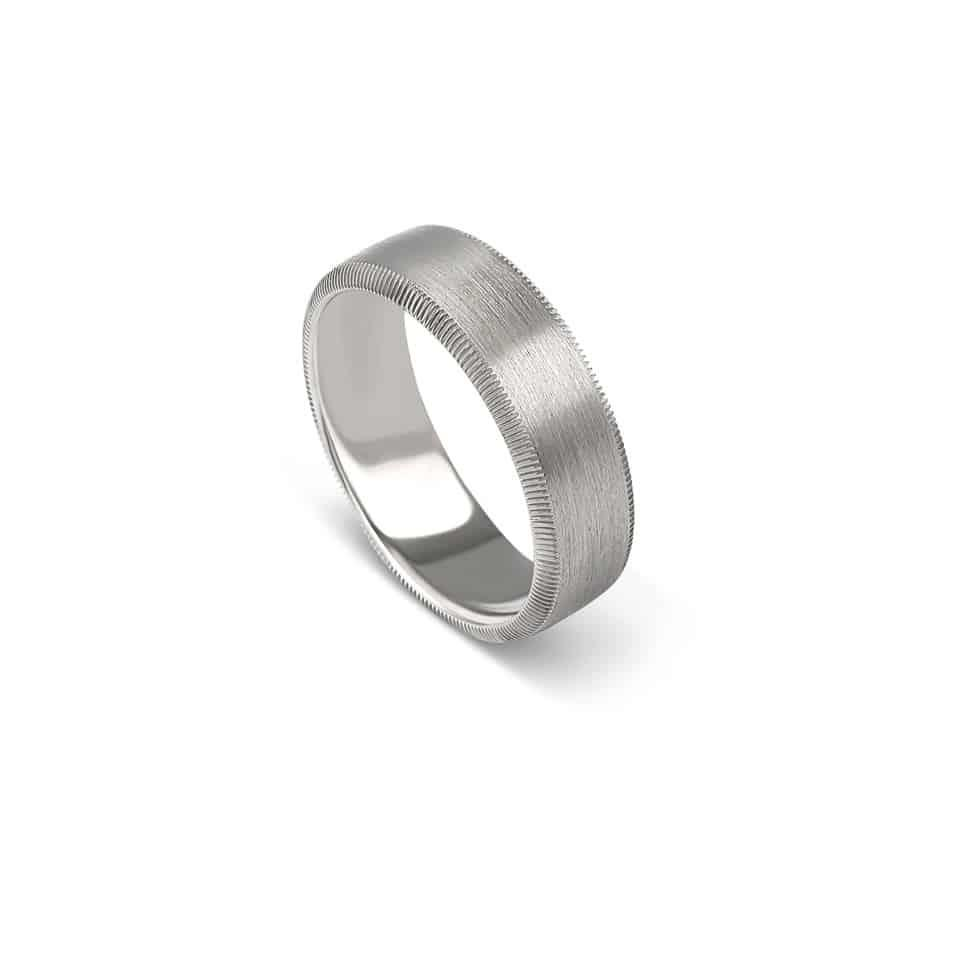 Your wedding may be designed to please everybody, but your ring needn't be. Try this sandblasted band – an example of one of Christian Bauer's distinctive textured weddings rings for men. Based near the Welzheim Forest in Germany, the Christian Bauer label draws inspiration from organic textures. This striking platinum band has a sandblasted effect with grooved edge. It has been crafted by the skilled jewellers at the CB workshop, who use technology and old-fashioned handiwork to realise each wedding ring design. It's also worth noting that Christian Bauer wedding rings are made using previously-mined metals, minimising the environmental impact. *Out of stock? Christian Bauer wedding rings are ordered to size. Please contact us via Live Chat.Authorised Christian Bauer London StockistMen's platinum wedding ringRing number 274468Metal: PlatinumWidth: 7.0 mm*Open Live Chat to order.Choosing a Christian Bauer wedding ringChristian Bauer wedding rings are exceptional. That's why we have been stocking them for many years. They're designed with experience and flair; bringing you comfort, fit, and style. The brand is based in rural Germany, operating from a state-of-the-art, eco-friendly premises. Although they've embraced technology in jewellery-making, their jewellers still do a lot of the work by hand. Because it's a lifetime investment, we think that a Christian Bauer wedding ring is worth every penny. If you're looking for a Christian Bauer wedding ring at a good price, ask us what we can do…