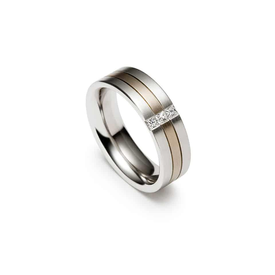 Christian Bauer Dual Shade Wedding RingYour wedding ring should reflect your individuality. Choose an elegantly distinct wedding ring like this one by Christian Bauer: contrasting the tones of platinum and white gold, it has a river of diamonds running right through. Your wedding ring is meaningful, and will accompany you for life: this one carries sparkle from start to end. It's a thoughtful choice, and also a wise one. Crafted with great care by the master jewellers at Christian Bauer, it is carefully tested, finished, and inspected before arriving at your door. *Christian Bauer wedding rings are ordered in your size (unless we have one in stock) – please use Live Chat or telephone the store to order your wedding ring.*Authorised Christian Bauer UK Stockist in LondonChristian Bauer Wedding Ring – 0243477Metal: Platinum and 18ct White GoldDiamond cut: PrincessSetting style: ChannelDiamond weight: 0.13ct white diamondsDiamond quality: White diamonds G-H Colour and VS ClarityFinger size pictured: TWidth: 6.5mmValues and standards at Christian BauerThe jewellers at Christian Bauer still incorporate many traditional skills into their work. But the production facility is a thoroughly modern eco-building, with its own water treatment works, and the latest state-of-the-art machinery. The jewellers blend handiwork and technology to bring your Christian Bauer wedding ring to life.Diamonds are selected from the top end of the quality scale and painstakingly hand-set for a flawless finish. Christian Bauer wedding rings are mostly made from platinum, the strongest precious metal, with highlights of white gold, yellow gold, and rose gold. Interestingly, the company will only use previously-mined metal – pledging to disturb no earth to create your wedding ring.