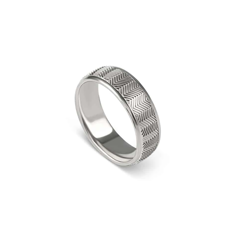 Christian BauerSolid 18ct white gold is given a handsome geometric pattern by the artisans at Christian Bauer. After more than 100 years of creating wedding rings, you'd expect Christian Bauer to be somewhat old-fashioned. But their high-tech, environmentally-friendly workshop in rural Germany is raising the bar – and so are their current wedding band designs. The world-famous ring-maker continues to set new precedents, like this highly original, geometric, zig-zagged men's wedding ring. Individually made in Germany, this design can be created in 18ct white gold (seen here), platinum, or palladium. White gold is a classic and contemporary choice with a warmer sheen than platinum. *Your Christian Bauer wedding ring will be ordered, unless we have your size in stock. Use Live Chat to enquire or order.*Authorised stockist of Christian Bauer rings in LondonMen's wedding ring – 274466Metal: 18ct white goldWidth: 7 mm*Open Live Chat to order.PureJewels – an authorised stockist of Christian Bauer in London.We've been selling Christian Bauer wedding rings for many years, and we appreciate the finer fit and comfort offered by this experienced ring designer. Despite being a hundred-year-old company, Christian Bauer launches some of the most cutting-edge wedding ring designs every year. Come into the showroom to see some of the latest, try them on for fit, and choose your favourite – then customise it by selecting the metal and width of your liking.