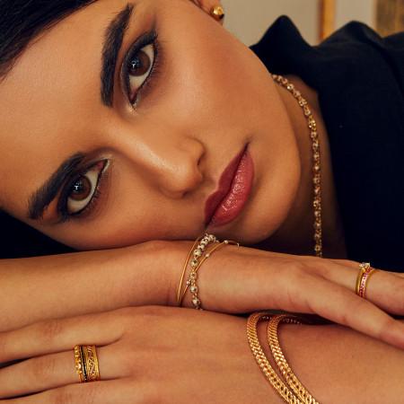 Model Wearing 22ct Layered jewellery