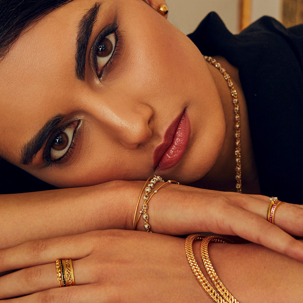 Model Wearing 22ct Layered jewellery